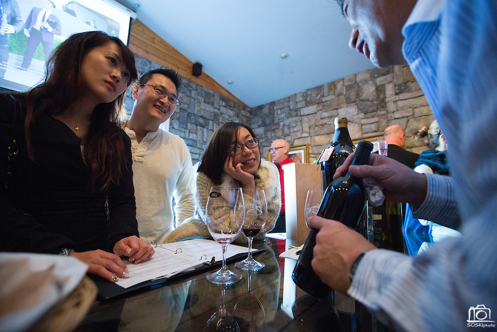 From left to right, Rita Chen of Fremont, Jimmy Cheng, and Sophie Lin, both of Milpitas, learn about and taste wine at Big Dog Vineyards in Milpitas, California, on January 5, 2014. Big Dog Vineyards is open for wine tasting the first full weekend of each month and is located at 4545 Felter Rd. (Stan Olszewski/SOSKIphoto)