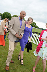 COLIN SALMON and FIONA HAWTHORNE at the 2013 Cartier Queens Cup Polo at Guards Polo Club, Berkshire on 16th June 2013.