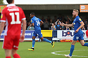 AFC Wimbledon midfielder Liam Trotter (14) celebrating after scoring goal to make it 1-2 during the EFL Sky Bet League 1 match between AFC Wimbledon and Scunthorpe United at the Cherry Red Records Stadium, Kingston, England on 15 September 2018.