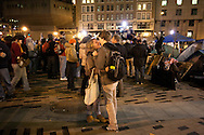 Boston, MA 12/08/2011.Tufts students share a kiss in Dewey Square during the Occupy Boston protest on Thursday night..Alex Jones / www.alexjonesphoto.com