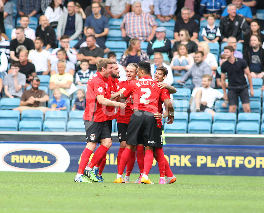 Ruben Lameiras of Coventry City (far right) is congratulated after making it 2-0 during the Sky Bet League 1 match between Millwall and Coventry City at The Den, London, England on 15 August 2015. Photo by Edmund  Boyden.