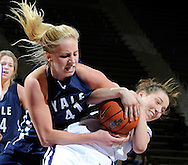 Forward Mandy Gobrecht #41 of the Yale Bulldogs fight for the ball with guard Brittany Chambers #2 of the Kansas State Wildcats at Bramlage Coliseum in Manhattan, Kansas.  ..