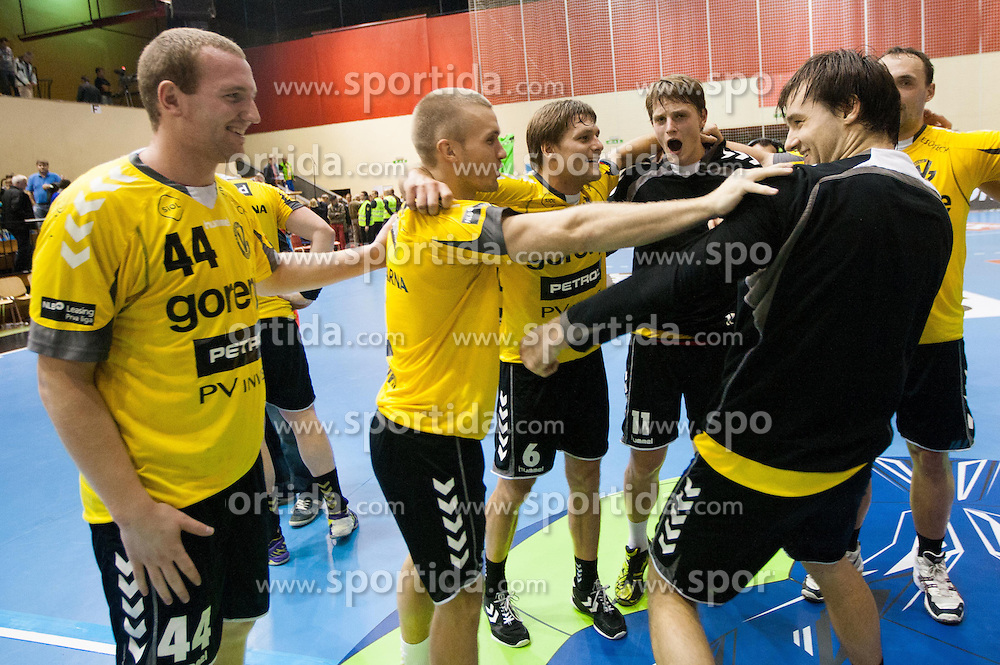 Players of Gorenje celebrate after the handball match between RK Gorenje Velenje (SLO) vs Bjerringbro-Silkeborg (DEN) in 4th Round of Group C of EHF Champions League 2012/13 on October 17, 2012 in Red hall, Velenje, Slovenia. Gorenje Velenje defeated Bjerringbro - Silkeborg 31-23. (Photo By Vid Ponikvar / Sportida)