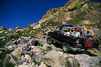 1999, Near Nice, France --- Tourists Driving Up a Rocky Hill --- Image by © Owen Franken/CORBIS
