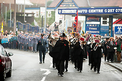 The local Remembrance Day Parade at Chapeltown Sheffield South Yorkshire which this year also marks the 90th Anniversary of the Royal British Legion is led off by local community constable PC Peter Booth...13 November 2011. Image © Paul David Drabble