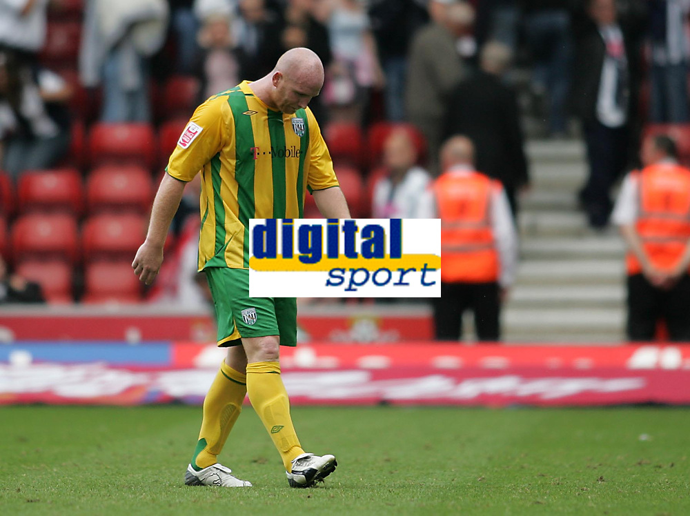 Photo: Lee Earle.<br /> Southampton v West Bromwich Albion. Coca Cola Championship. 12/08/2006. Albion's John Hartson leaves the pitch.