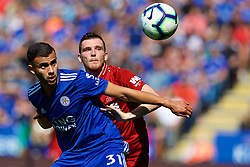 LEICESTER, ENGLAND - Saturday, September 1, 2018: Liverpool's Andy Robertson and Leicester City's Rachid Ghezzal during the FA Premier League match between Leicester City and Liverpool at the King Power Stadium. (Pic by David Rawcliffe/Propaganda)