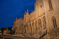 The exterior of Avignon Castle, France, at night.