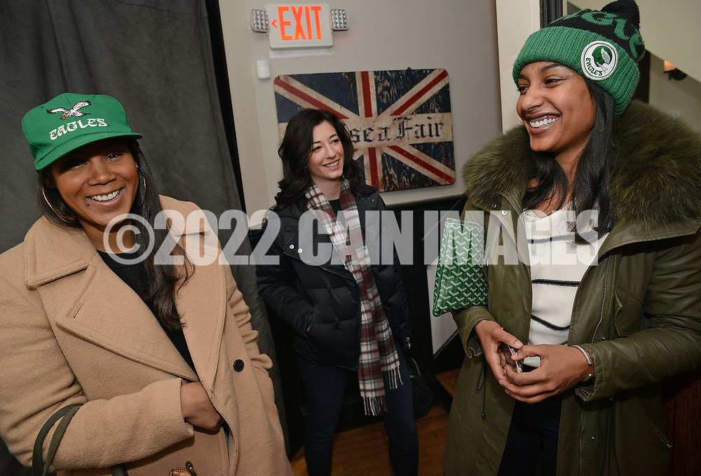 From left, Philadelphia Eagles fans Ashley Moore of New York, Shanna Cox of New York and Jennifer Burks of Philadelphia arrive to enjoy brunch at Pub & Kitchen Sunday, February 04, 2018 in Philadelphia, Pennsylvania. The pub added Bleeding Green Bloody Marys and Crispy Fried Brady Chicken to the menu.  WILLIAM THOMAS CAIN / For The Inquirer