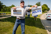 "08 AUGUST 2020 - WEST DES MOINES, IOWA: GARY LEFFLER, from West Des Moines, cheers for law enforcement during a rally to support law enforcement in West Des Moines. About 100 people gathered at the West Des Moines Law Enforcement Center to rally in support of law enforcement. The rally was organized by ""Uplifting Our Police,"" a local organization that supports law enforcement. They rallied at Des Moines Police headquarters in July. They are planning similar rallies at police stations in the Des Moines metropolitan area.     PHOTO BY JACK KURTZ"