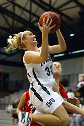 10 January 2009: Hope Schulte is airborne looking for the hoop. The Illinois Wesleyan Titans, ranked #1 in the latest USA Today/ESPN poll, take down the Lady Reds of Carthage and remain undefeated,  2-0 in the CCIW and over all to 12-0. This is the first time in the history of the Lady Titans Basketball they have been ranked #1 The Titans and Lady Reds played in the Shirk Center on the Illinois Wesleyan Campus in Bloomington Illinois.
