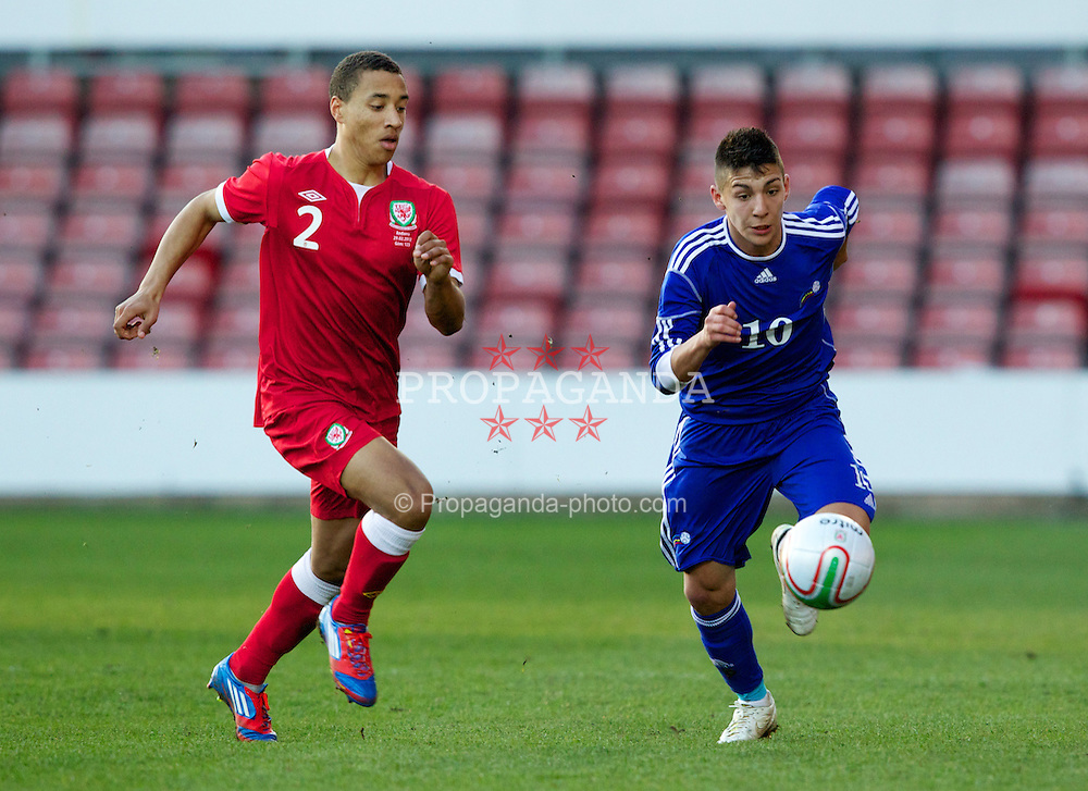 WREXHAM, WALES - Wednesday, February 29, 2012: Wales' Adam Henley (Blackburn Rovers) and Andorra's Cristopher Pousa (FC Santa Coloma) during the UEFA Under-21 Championship Qualifying Group 3 match at the Racecourse Ground. (Pic by Vegard Grott/Propaganda)