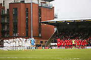 Both teams hold a minute's silence before the EFL Sky Bet League 2 match between Leyton Orient and Barnet at the Matchroom Stadium, London, England on 7 January 2017. Photo by Jack Beard.