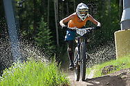 Beth Roberts competes in Stage 4 of the Keystone Big Mountain Enduro in Keystone, CO. ©Brett Wilhelm