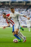 Real Madrid's Cristiano Ronaldo and Atletico de Madrid's Juanfran Torres during La Liga match between Real Madrid and Atletico de Madrid at Santiago Bernabeu Stadium in Madrid, April 08, 2017. Spain.<br /> (ALTERPHOTOS/BorjaB.Hojas)