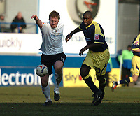 Photo: Ian Hebden.<br /> <br /> Luton Town v Derby County. Coca Cola Championship. 18/03/2006.<br /> <br /> Lutons Steve Howard (L) gets to the ball ahead of Derbys Darren Moore (R).