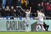 Goal - Andre Ayew (22) of Swansea City celebrates after he scores a goal to make the score 2-1 during the EFL Sky Bet Championship match between Swansea City and Middlesbrough at the Liberty Stadium, Swansea, Wales on 14 December 2019.