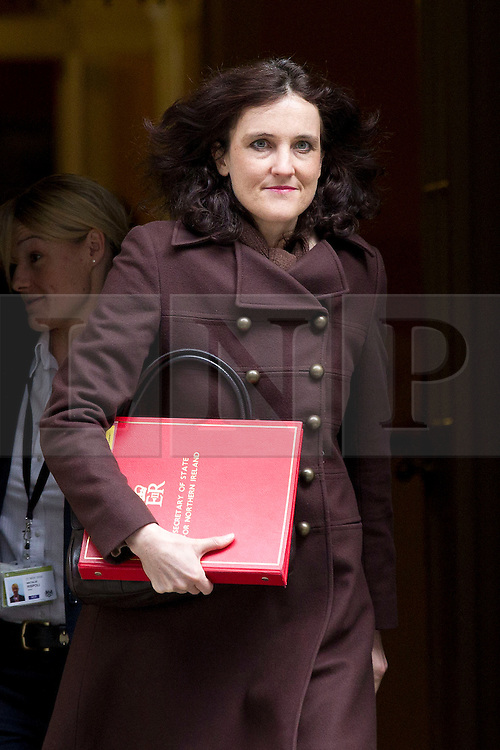 © Licensed to London News Pictures. 18/03/2014. London, UK. The Northern Ireland Secretary, Theresa Villiers, leaves a meeting of the British cabinet on Downing Street in London today (18/03/2014). Photo credit: Matt Cetti-Roberts/LNP