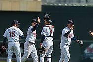 Joe Mauer #7 of the Minnesota Twins celebrates with teammates after the Twins defeated the Miami Marlins in Game 1 of a split doubleheader on April 23, 2013 at Target Field in Minneapolis, Minnesota.  The Twins defeated the Marlins 4 to 3.  Photo: Ben Krause