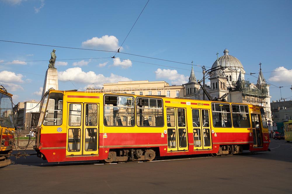 Poland Western Mazovia Lodz Tram passing through Plac Wolnosci (Liberty Square) statue of Tadeusz Kosciuszko
