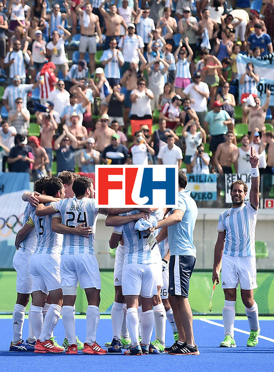 Argentina's players celebrate winning the men's semifinal field hockey Argentina vs Germany match of the Rio 2016 Olympics Games at the Olympic Hockey Centre in Rio de Janeiro on August 16, 2016. / AFP / MANAN VATSYAYANA        (Photo credit should read MANAN VATSYAYANA/AFP/Getty Images)