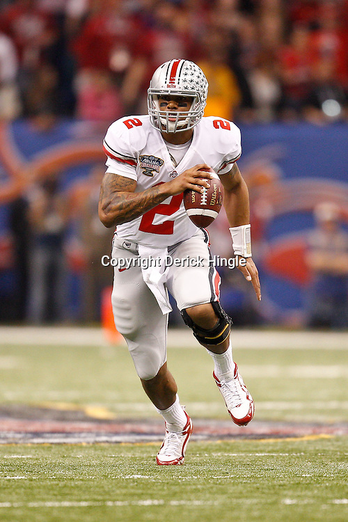 January 4, 2011; New Orleans, LA, USA;  Ohio State Buckeyes quarterback Terrelle Pryor (2) runs with the ball during the first quarter of the 2011 Sugar Bowl against the Arkansas Razorbacks at the Louisiana Superdome.  Mandatory Credit: Derick E. Hingle