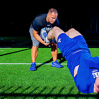 SARASOTA, FL -- Men's Fitness editor Sean Hyson runs through training and exercises with Scott Gadeken, Head of Physical Conditioning at IMG Academy in Bradenton, Fla., on Friday, March 21, 2014. (PHOTO / CHIP LITHERLAND)