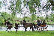 © Licensed to London News Pictures. 15/05/2014. Windsor, UK. People drive their horses along the banks of the River Thames.  The second day of The Royal Windsor Horse Show, set in the grounds of Windsor Castle. Established in 1943. Photo credit : Stephen Simpson/LNP