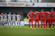 both teams observe a minute silence at the start of the game during the EFL Sky Bet League 2 match between Crawley Town and Grimsby Town FC at the Checkatrade.com Stadium, Crawley, England on 26 November 2016. Photo by Jarrod Moore.