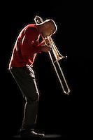 Man Playing Trombone side view