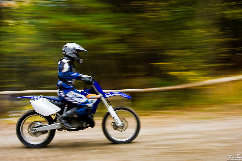 Panned image of a dirt bike rider on the trails of the Ganaraska Forest.