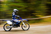 Panned image of a dirt bike rider on the trails of Ganaraska.
