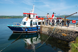 Maid of the Forth tourist boat at Inchcolm Island on Firth of Forth in Scotland, UK