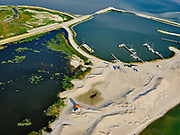 Nederland, Flevoland, Markermeer, 26-08-2019; Marker Wadden in het Markermeer. Westkust met duinen en vogel kijktoren (met rood dak), nabij de haven  (rechts).<br /> Doel van het project van Natuurmonumenten en Rijkswaterstaat is natuurherstel, met name verbetering van de ecologie in het gebied, in het bijzonder de kwaliteit van bodem en water<br /> Naast het hoofdeiland is er inmiddels een tweede eiland in wording, de uiteindelijk Marker Wadden archipel zal uit vijf eilanden bestaan. <br /> Marker Wadden, artifial islands. The aim of the project is to restore the ecology in the area, in particular the quality of soil and water.<br /> The first phase of the construction, the main island, is finished. <br /> <br /> luchtfoto (toeslag op standard tarieven);<br /> aerial photo (additional fee required);<br /> copyright foto/photo Siebe Swart