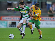 Yeovil - Tuesday, August 11th, 2009: Andrew Walsh of Yeovil and Wes Hoolahan of Norwich City during the Carling Cup 1st Round match at Yeovil. (Pic by Alex Broadway/Focus Images)