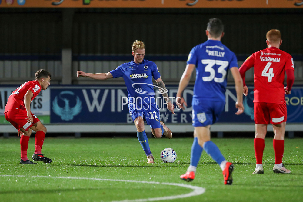 AFC Wimbledon midfielder Mitchell (Mitch) Pinnock (11) passing the ball during the Leasing.com EFL Trophy match between AFC Wimbledon and Leyton Orient at the Cherry Red Records Stadium, Kingston, England on 8 October 2019.