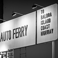 Newport Beach Auto Ferry sign at night black and white photo. The auto ferry carries passengers between Balboa Peninsula and Balboa Island in Orange County California. Photo is high resolution. Copyright ⓒ 2017 Paul Velgos with All Rights Reserved.