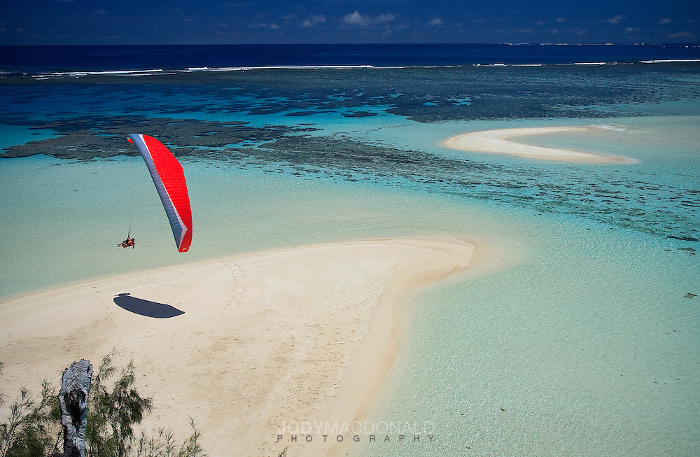 Imagine flying where none ever have.  That's exactly what we did, paragliding in Tonga on board The Best Odyssey.  In this image professional paraglider Stu Belbas lands our new Gin Rebel wing on a desserted beach surrounded by stunning lagoon.