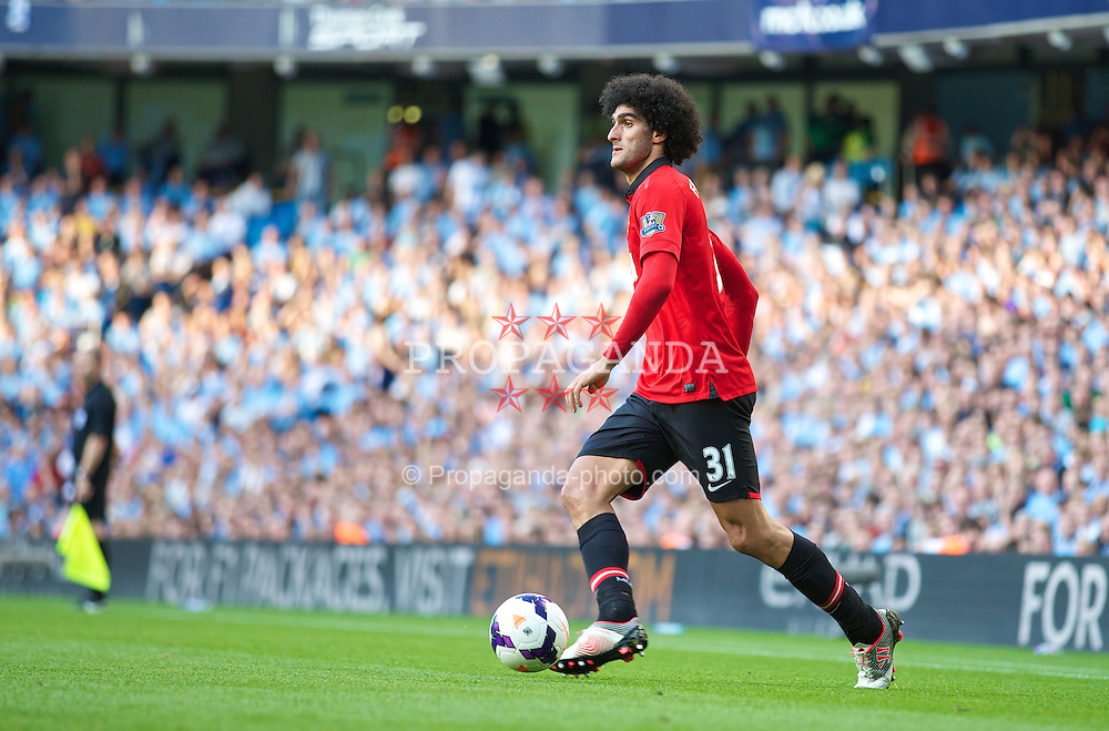 MANCHESTER, ENGLAND - Sunday, September 22, 2013: Manchester United's Marouane Fellaini in action against Manchester City during the Premiership match at the City of Manchester Stadium. (Pic by David Rawcliffe/Propaganda)