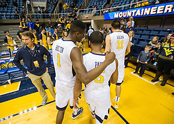 Dec 5, 2015; Morgantown, WV, USA; West Virginia Mountaineers guard Jaysean Paige (5) and forward Jonathan Holton (1) walk off the floor together after their game against the Kennesaw State Owls at WVU Coliseum. Mandatory Credit: Ben Queen-USA TODAY Sports
