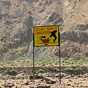 Landmine warning sign along banks of Pyanj (Amu Darya) River