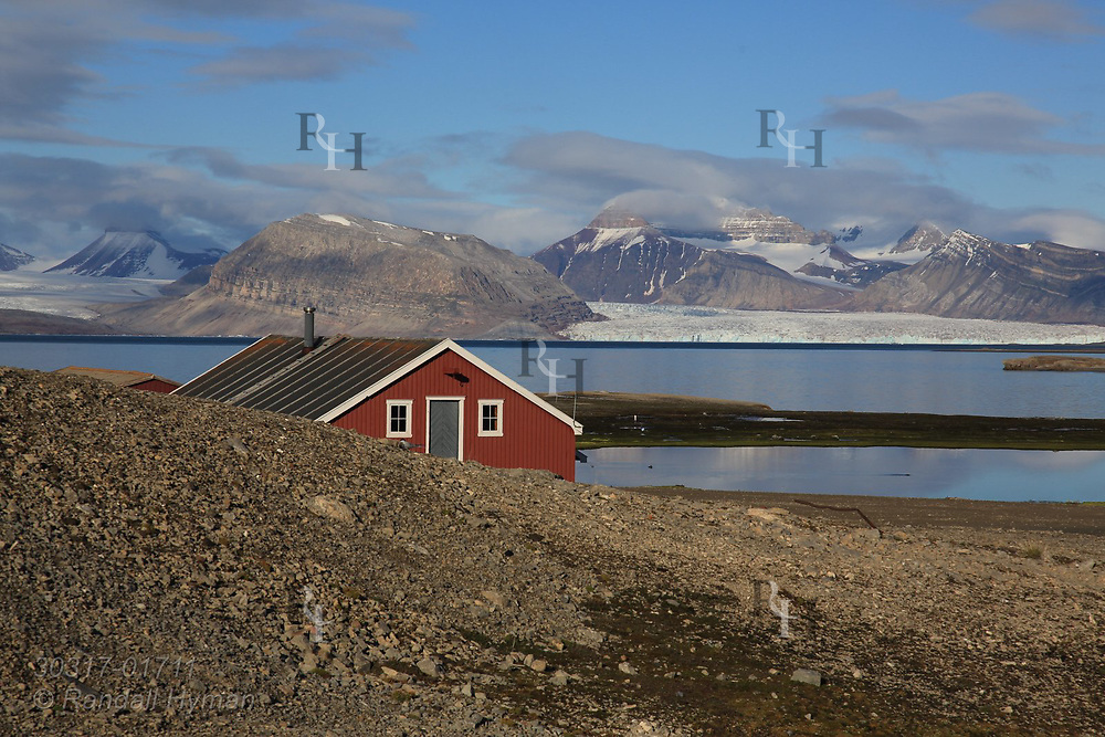 Mellageret Kafe, once a flour warehouse, stands on outskirts of the international science village of Ny-Alesund on shores of Kongsfjorden; Spitsbergen, Svalbard, Norway.