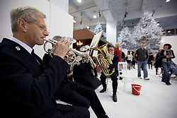 © Licensed to London News Pictures. 14/11/2012. London, UK. Visitors past a Salvation Army band at the opening of the 2012 Ideal Home at Christmas show at Earl's Court, London, today (14/11/12). The show, running from the 14th to the 18th of November features over 600 exhibitors across 6 sections including; Interiors & Furnishings, Food & Drink, Home Improvements & Outdoor Living, Fashion & Beauty, Technology & Gadgets and Gifts & Decorations. Photo credit: Matt Cetti-Roberts/LNP