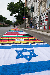 8th July, 2017. Hamburg, Germany. Many country flags stitched together and placed on road during G20 summit in Hamburg
