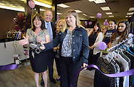 DOYLESTOWN, PA - AUGUST 23:  Donna Fedoriak (L), store manager and Kriston Ortlieb-Potts (5th from left), President of the Board of Directors for A Woman's Place  along with Doylestown Mayor Ron Strouse (2nd from left) cut the ribbon at the grand opening of In Full Swing, A Woman's Place's newly designed and relocated thrift shop August 23, 2014 in Doylestown, Pennsylvania. Staff and custo,era stand in the background. (Photo by William Thomas Cain/Cain Images)