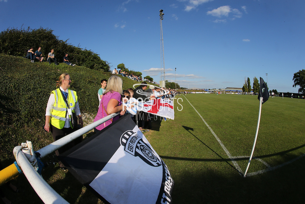 Fans with flags during the FA Vase 1st Qualifying Round match between Worthing United and East Preston FC at the Robert Eaton Memorial Ground, Worthing, United Kingdom on 6 September 2015. The first home match for Worthing United since losing team mates Matthew Grimstone and Jacob Schilt in the Shoreham air show disaster.