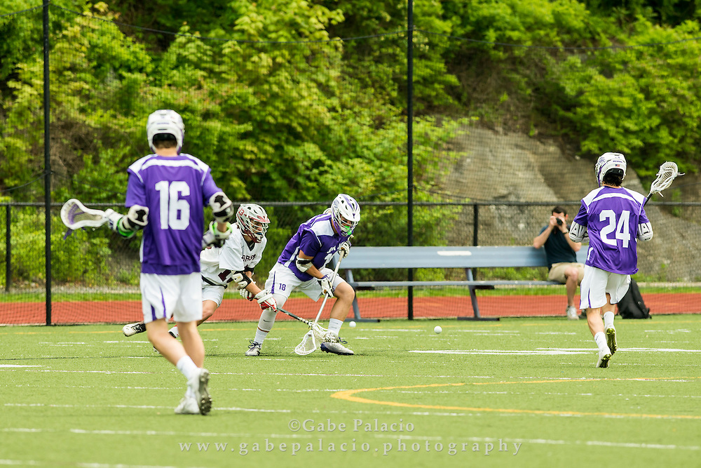 John Jay Varsity Lacrosse game at Harrison High School on May 16, 2015. (photo by Gabe Palacio)
