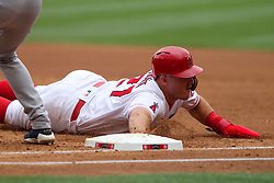 May 20, 2018 - Anaheim, CA, U.S. - ANAHEIM, CA - MAY 20: Mike Trout (27) of the Angels dives safely back into first base during the major league baseball game between the Tampa Bay Rays and the Los Angeles Angels on May 20, 2018 at Angel Stadium of Anaheim in Anaheim, California. (Photo by Cliff Welch/Icon Sportswire) (Credit Image: © Cliff Welch/Icon SMI via ZUMA Press)