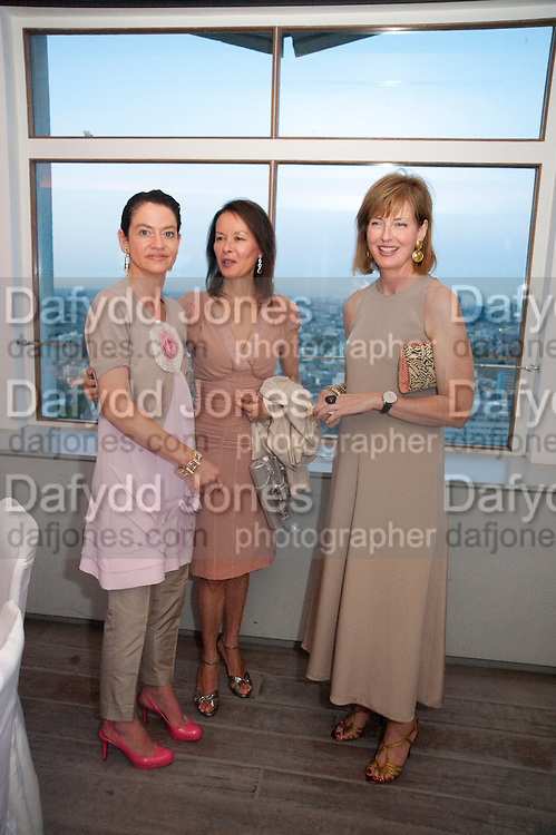 CORINNE FLICK; ALMINE RUIZ-PICASSO; JULIA PEYTON-JONES, Dinner hosted by Julia Peyton-Jones and Hans Obrist for the Council of the Serpentine to celebrate: Jeff Koons, Popeye Series. Paramount Club, Paramount Centre Point. London. 30 June 2009
