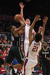 Colorado guard George King, left, is defended by Stanford's Cameron Walker (21) and Michael Humphrey, back, during the first half of an NCAA college basketball game in Stanford, Calif., Sunday, Jan. 3, 2016. Colorado won 56-55. (AP Photo/Jason O. Watson)